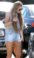 Miley Cyrus wears really short jeans shorts whilst out in Toluca Lake with a friend, Los Angeles, USA